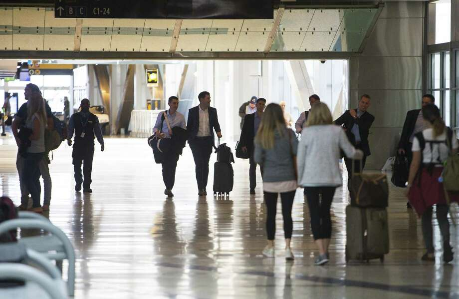 Travelers move through Bush Intercontinental Airport, Tuesday, March 20, 2018, in Houston. ( Mark Mulligan / Houston Chronicle ) Photo: Mark Mulligan, Houston Chronicle / Houston Chronicle / © 2018 Houston Chronicle