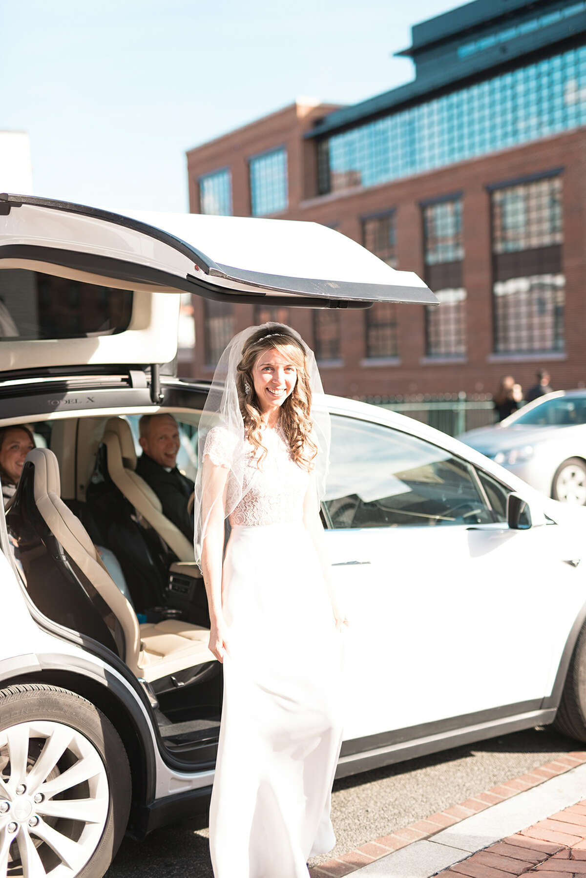 Alexi Hoeft and Alexander Hart of Washington, D.C. get married, adding in bits of the couple's love of Tesla throughout the ceremony and reception.