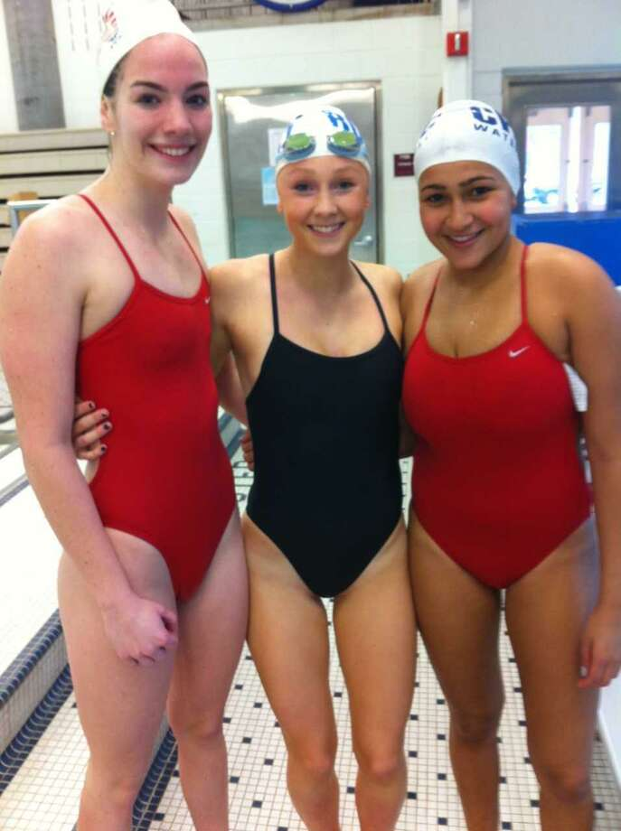 From left, Annie Robinson, Kellen Carlson and Mariam Obaiah are the senior captains of the Greenwich High School girls water polo team. Photo: David Fierro / Hearst Connecticut Media