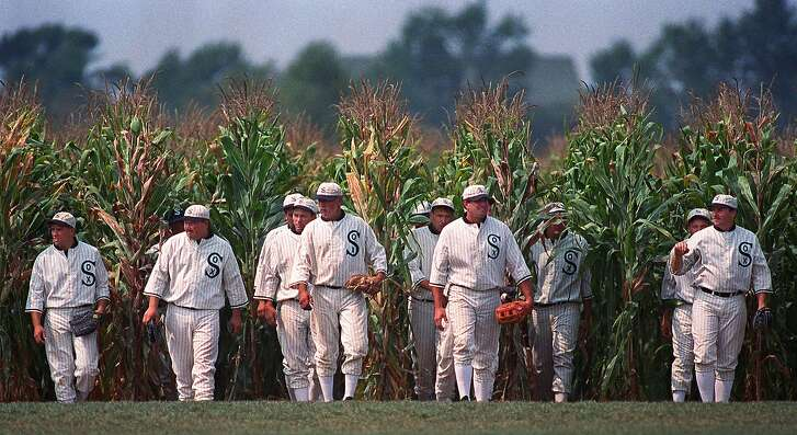 """Persons portraying ghost player characters, similar to those in the film """"Field of Dreams,"""" emerge from the cornfield at the """"Field of Dreams"""" movie site in Dyersville, Iowa, in this undated file photo. (AP Photo/Charlie Neibergall/FILE)"""