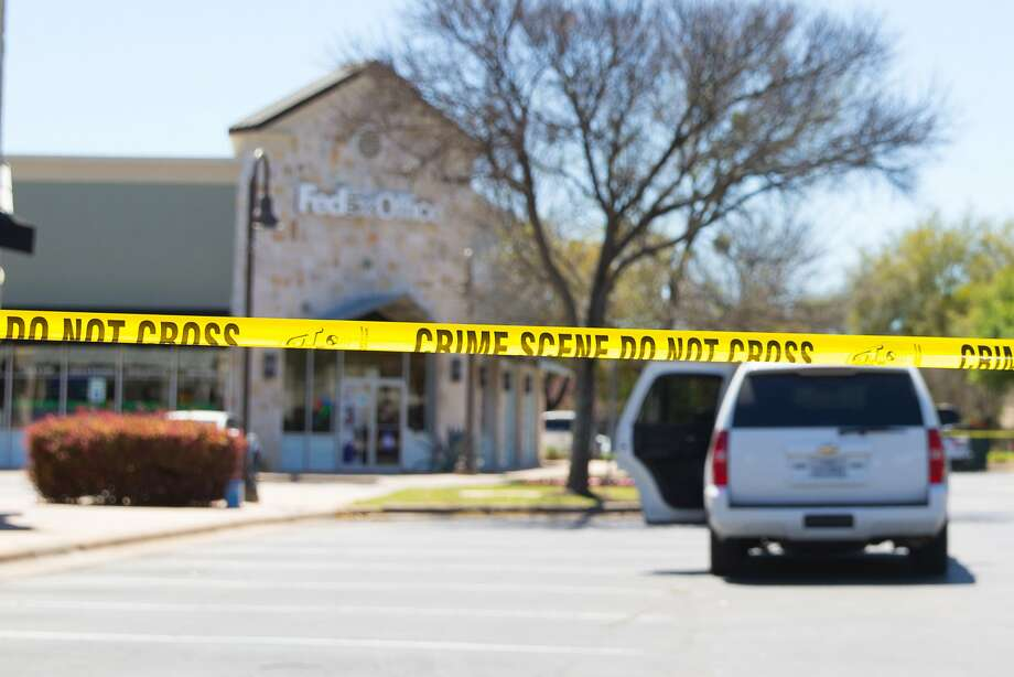 Police and FBI Agents investigate at the Sunset Valley FedEx store located on Brodie Lane in Austin, Texas, which is linked to the package bomb which exploded on a conveyor belt in the sorting facility in Schertz, Texas on March 20, 2018. A package exploded at a FedEx distribution facility in Texas, news reports said, two days after the latest in a series of blasts in Austin attributed to a serial bomber. / AFP PHOTO / SUZANNE CORDEIROSUZANNE CORDEIRO/AFP/Getty Images Photo: SUZANNE CORDEIRO, AFP/Getty Images
