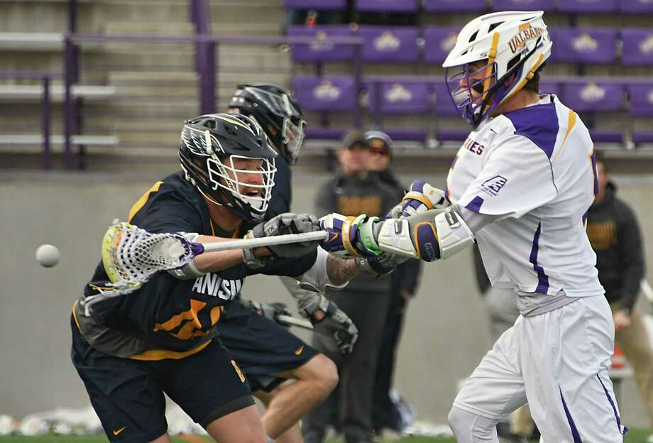 University at Albany's Connor Fields is defended by Canisius' Holden Garlent as he scores during a lacrosse game at Casey Stadium on Tuesday, March 20, 2018 in Albany, N.Y. (Lori Van Buren/Times Union) Photo: Lori Van Buren, Albany Times Union / 20043264A