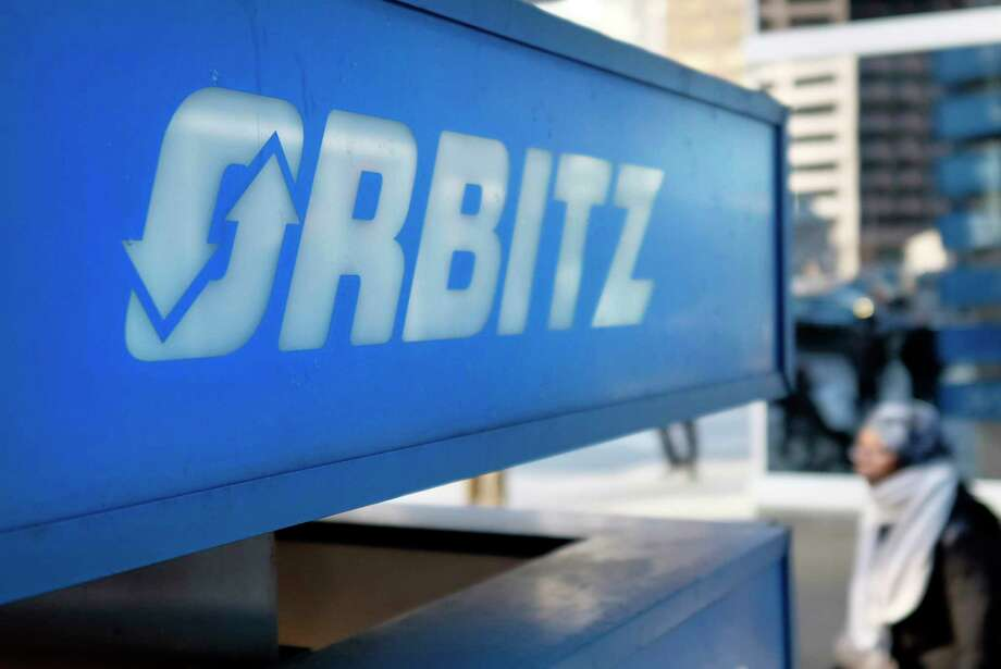 FILE - This Feb. 12, 2015 file photo shows signage for travel booking site Orbitz outside the building that houses its headquarters, in Chicago. Orbitz says a legacy travel booking platform may have been hacked, potentially exposing the personal information of people that made purchases between Jan. 1, 2016 and Dec. 22, 2017. The company said Tuesday, March 20, 2018, about 880,000 payment cards were impacted. (AP Photo/Kiichiro Sato, File) Photo: Kiichiro Sato / Copyright 2018 The Associated Press. All rights reserved.