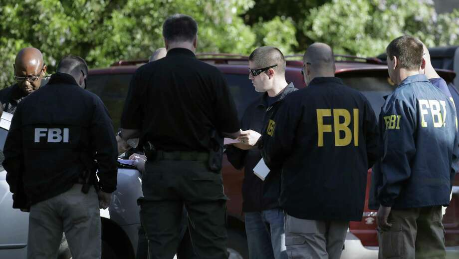 "FBI agents investigate Sunday's deadly explosion in Austin. This blast that was triggered by a tripwire demonstrated what police said was a ""higher level of sophistication"" than the package bombs used in the previous attacks. Photo: Eric Gay, STF / Associated Press / Copyright 2018 The Associated Press. All rights reserved."