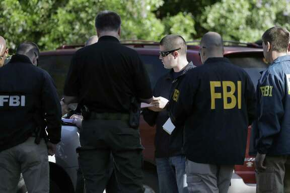 "FBI agents investigate Sunday's deadly explosion in Austin. This blast that was triggered by a tripwire demonstrated what police said was a ""higher level of sophistication"" than the package bombs used in the previous attacks."