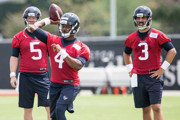 Houston Texans quarterback Deshaun Watson (4) throws a pass, with Brandson Weeden (5) and Tom Savage (3) looking on, during OTAs at The Methodist Training Center on Wednesday, May 31, 2017, in Houston. ( Brett Coomer / Houston Chronicle )