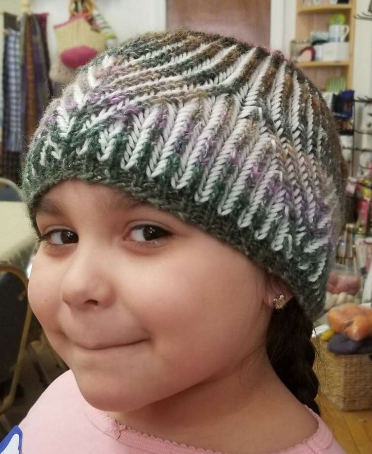 Ginger Balch's granddaughter, Arianna, models her new Brioche hat. Photo: Photo By Ginger Balch