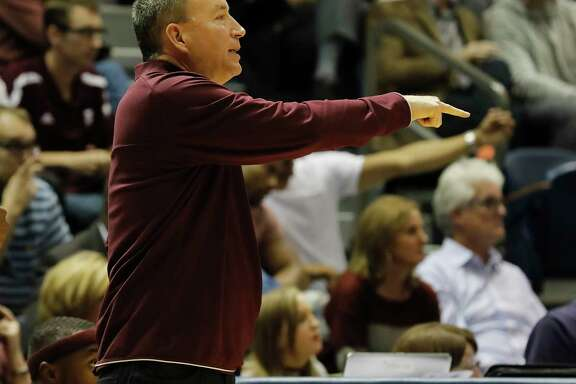 Texas A&M Aggies head coach Billy Kennedy reacts on the bench during the exhibition basketball game between the Texas Longhorns and the Texas A&M Aggies to benefit the Rebuild Texas Relief Fund at Tudor Fieldhouse in Houston, TX on Wednesday, October 25, 2017.