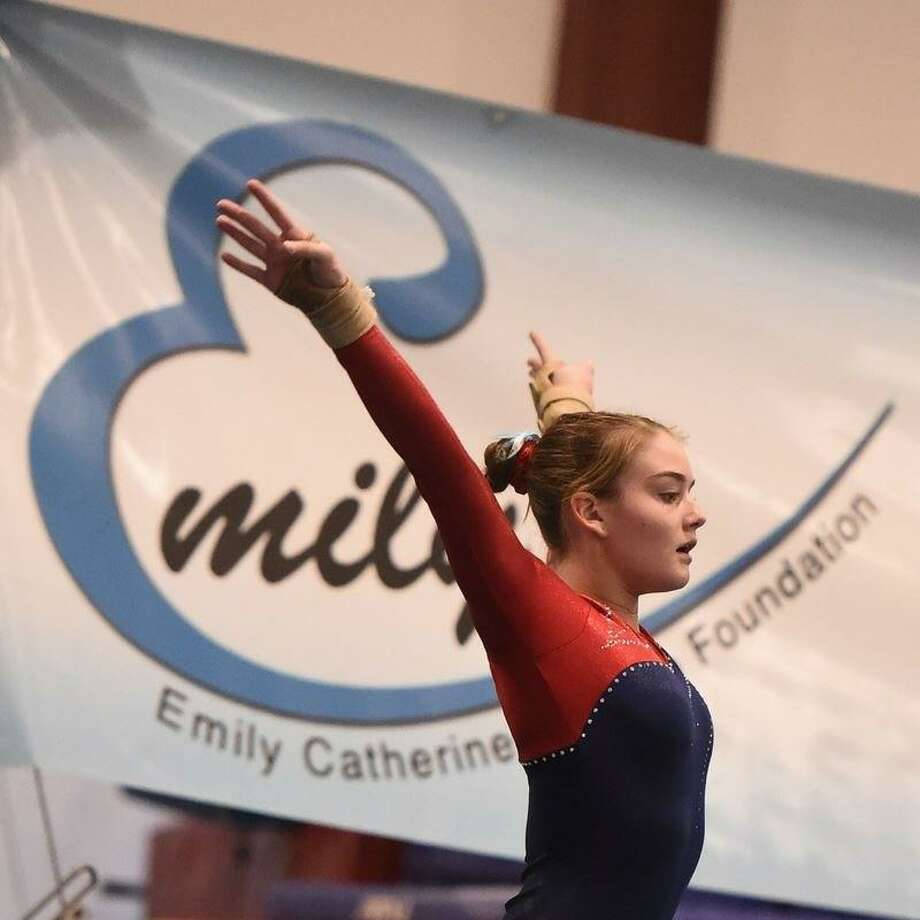 Darien YMCA Level 9 gymnast Kelsey Fedorko salutes after her floor routine, where she scored 9.3 at the 2018 Emily Fedorko Challenge honoring her sister. Photo: TeamPhoto / Contributed Photo / Darien News contributed