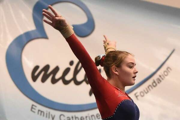 Darien YMCA Level 9 gymnast Kelsey Fedorko salutes after her floor routine, where she scored 9.3 at the 2018 Emily Fedorko Challenge honoring her sister.