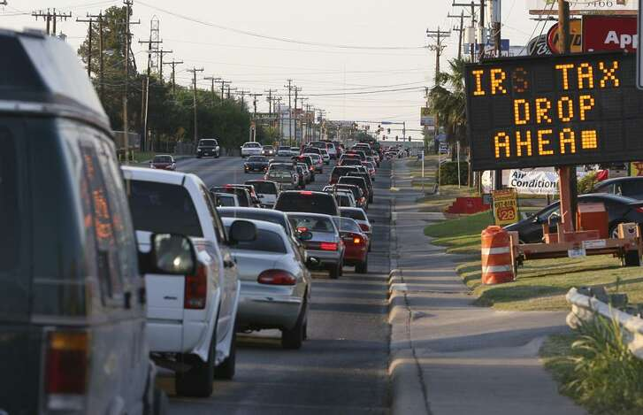 A sign advises motorists of an IRS tax drop-off location a half-mile before the post office on Perrin Beitel Road in northeast San Antonio. Bumper to bumper traffic was spotted from Loop 410 north on Perrin-Beitel as people hurried to drop off their income tax April 15, 2008.