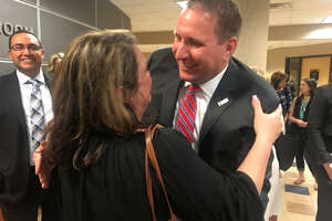 Conroe ISD Deputy Superintendent Curtis Null hugs a well-wisher after he is named the lone finalist to become the suburban district's next superintendent.