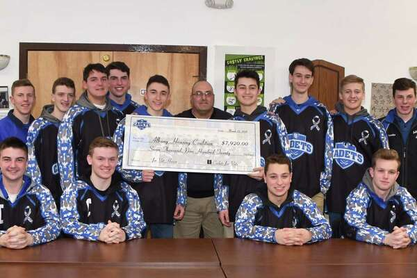 """The La Salle Hockey Team presents $7,920 to Lee R. Vartigan, director of veterans services, Albany Housing Coalition at the Vet House, 180 First St., Albany. The funds were raised at the """"Cadets for Vets"""" hockey game vs Shaker-Colonie on Jan. 20. (Submitted by Bill Murray)"""