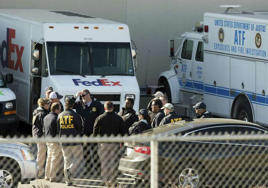 Federal officials investigate the scene Tuesday morning March 20, 2018 of a package bomb explosion at the FedEx ground shipping facility in Schertz. Officials have said the bomb appeared to be related to the four recent package explosions in Austin. Photo: William Luther, Staff / San Antonio Express-News / © 2018 San Antonio Express-News
