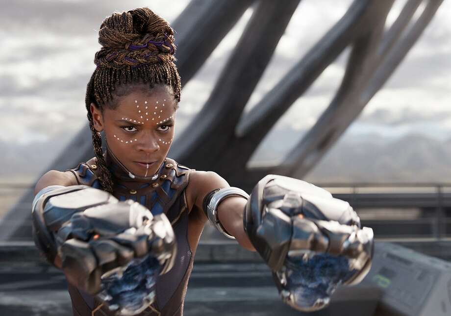 """IN: Afrofuturism, as typified by the Afrofuturist blockbuster """"Black Panther."""" Actress Letitia Wright pictured in a still from the film. Photo: Film Frame, Marvel Studios-Walt Disney"""