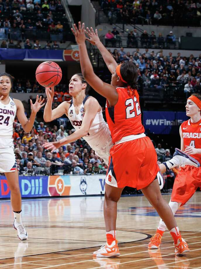 INDIANAPOLIS, IN - APRIL 05: Kia Nurse #11 of the Connecticut Huskies falls as she goes up for a shot against Taylor Ford #22 of the Syracuse Orange in the third quarter during the championship game of the 2016 NCAA Women's Final Four Basketball Championship at Bankers Life Fieldhouse on April 5, 2016 in Indianapolis, Indiana.  (Photo by Joe Robbins/Getty Images) ORG XMIT: 598514269 Photo: Joe Robbins / 2016 Getty Images