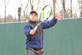 Edwardsville junior Seth Lipe makes a backhand return during his No. 3 singles match on Tuesday in the Tigers' Southwestern Conference match at Alton.