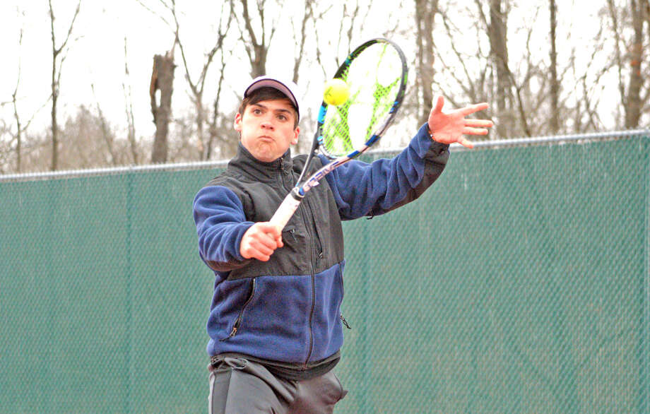 Edwardsville junior Seth Lipe makes a backhand return during his No. 3 singles match against Alton earlier this season.