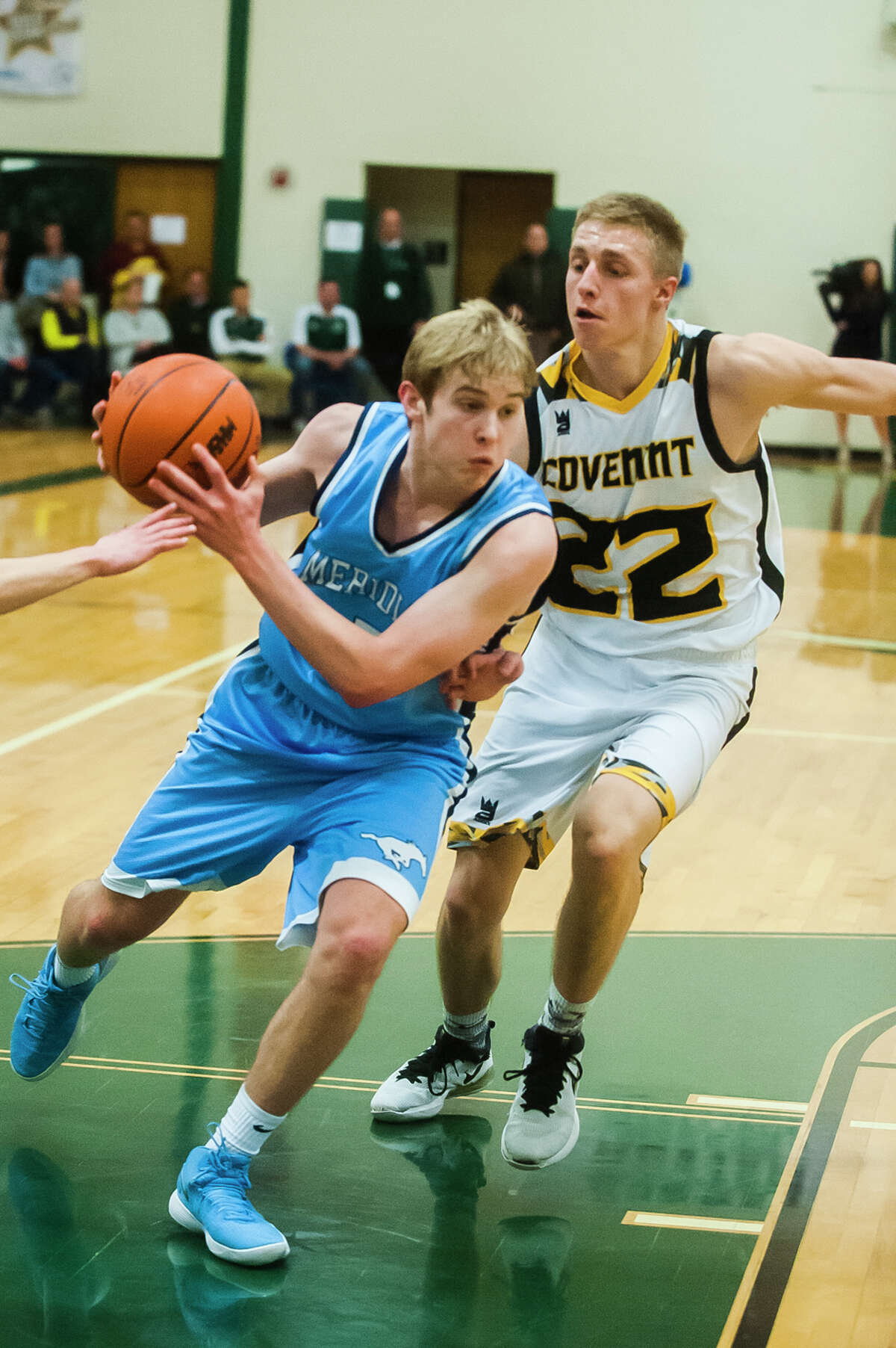 Meridian senior Garrett Stockford dribbles toward the basket during the Mustangs' 53-30 loss to Grand Rapids Covenant Christian in the Class C state semifinals on Tuesday, March 20, 2018 at Central Montcalm High School in Stanton. (Katy Kildee/kkildee@mdn.net)