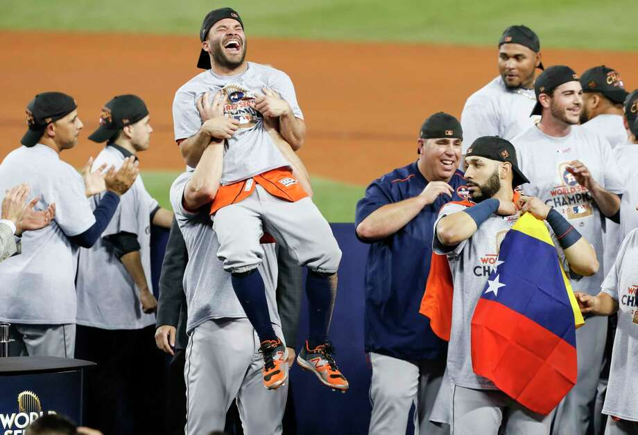 PHOTOS: Jose Altuve's Top 7 MomentsHouston Astros second baseman Jose Altuve (27) is hoisted in the air at the Houston Astros celebrate beating the Los Angeles Dodgers 5-1 in Game 7 of the World Series at Dodger Stadium on Wednesday, Nov. 1, 2017, in Los Angeles. The Astros took the Series 4-games-to-3 to capture the franchise's first title. ( Brett Coomer / Houston Chronicle )Browse through the photos to see the top seven moments of Jose Altuve's Astros career. Photo: Brett Coomer, Staff / © 2017 Houston Chronicle