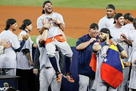 Houston Astros second baseman Jose Altuve (27) is hoisted in the air at the Houston Astros celebrate beating the Los Angeles Dodgers 5-1 in Game 7 of the World Series at Dodger Stadium on Wednesday, Nov. 1, 2017, in Los Angeles. The Astros took the Series 4-games-to-3 to capture the franchise's first title. ( Brett Coomer / Houston Chronicle )