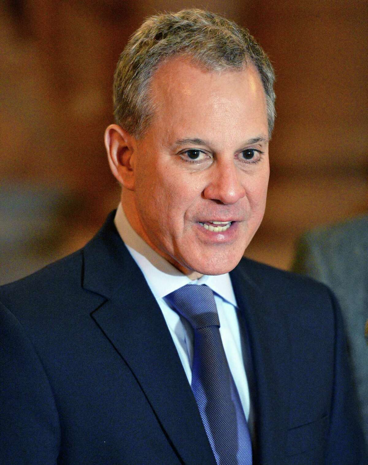 FILE - Attorney General Eric Schneiderman releases a report on voting rights across the state, detailing the results of his inquiry into the unprecedented level of voting complaints regarding the April 2016 presidential primary during a news conference at the Capitol Tuesday Dec. 6, 2016 in Albany, NY. (John Carl D'Annibale / Times Union)
