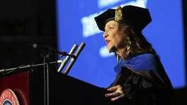 UTSA Professor and former Texas Poet Laureate Carmen Tafolla recites a poem she wrote for Eighmy.