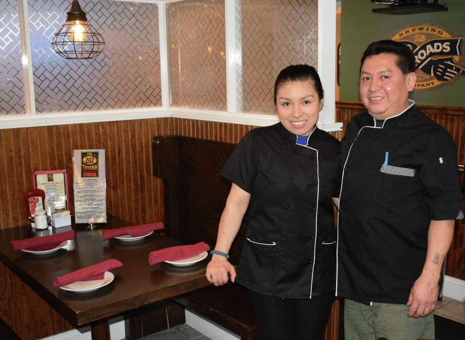 Oscar Lopez opened the Route 202 Tavern on Route 202, just over the Washington town line, last summer. He is shown above with his daughter, Monica, who works at the restaurant. Photo: Deborah Rose / Hearst Connecticut Media / The News-Times  / Spectrum