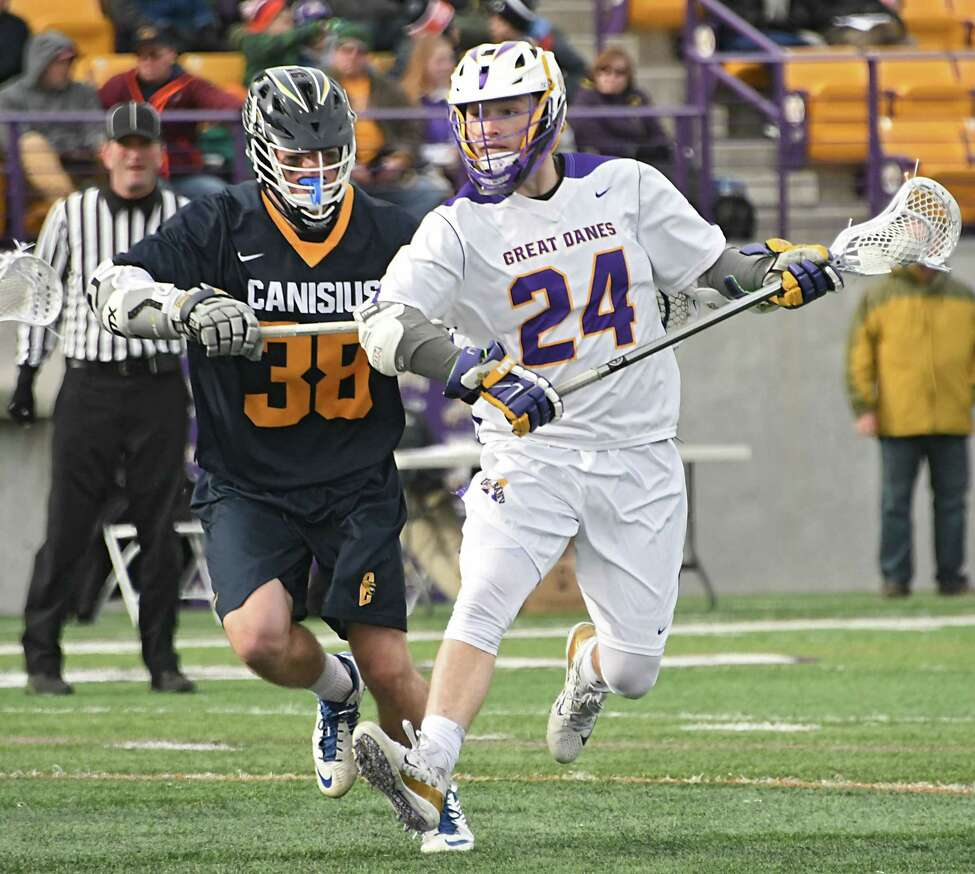 University at Albany's Alex Burgmaster is defended by Canisius' John McCain during a lacrosse game at Casey Stadium on Tuesday, March 20, 2018 in Albany, N.Y. (Lori Van Buren/Times Union)