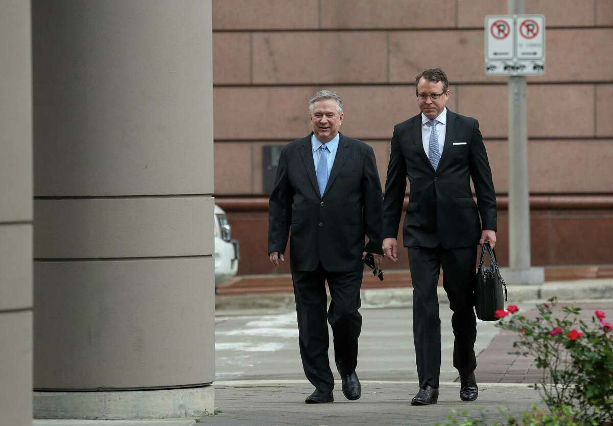 Former U.S. Congressman Steve Stockman (left) and attorney Sean Buckley walk into the federal courthouse Monday for the start of federal corruption trial against Stockman.