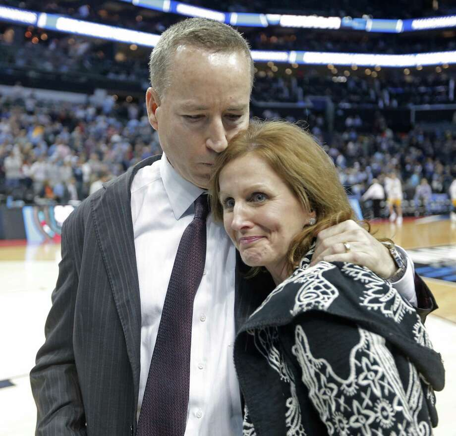 Texas A&M head coach Billy Kennedy, hugs his wife, Mary, after defeating North Carolina on Sunday in Charlotte, N.C. Photo: Bob Leverone / Associated Press / FR170480 AP