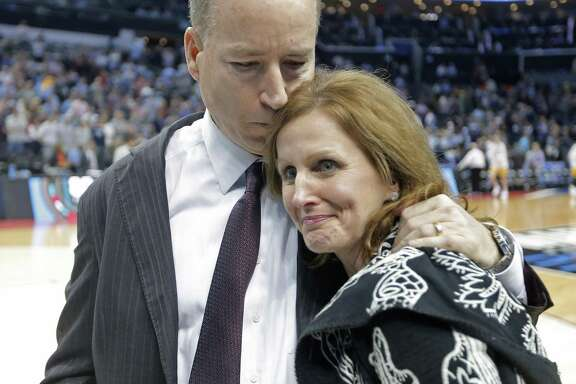 Texas A&M head coach Billy Kennedy, hugs his wife, Mary, after defeating North Carolina on Sunday in Charlotte, N.C.