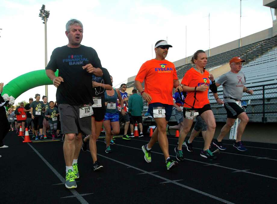 Runners take part in a 5K run at Buddy Moorhead Stadium in 2017 in Conroe. The Conroe High School Alumni Association's inaugural run raised money for the Jimmy Schorck Memorial Senior Scholarship. Photo: Jason Fochtman, Staff Photographer / © 2017 Houston Chronicle
