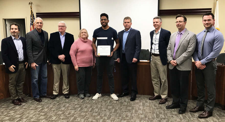 EHS senior student Marcus Kwasa, center, poses with city aldermen and Edwardsville Mayor Hal Patton after receiving a commendation award at Tuesday's City Council meeting. Photo: Cody King • Cking@edwpub.net