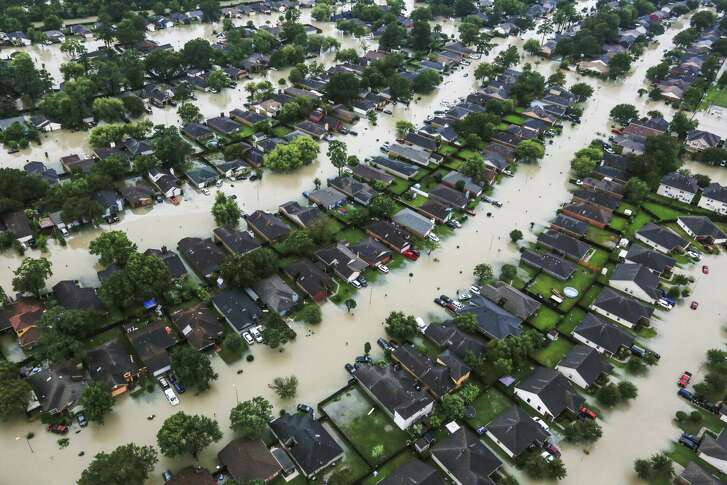 A neighborhood is inundated by floodwaters from Hurricane Harvey near east Interstate 10 in Houston on Aug. 29, 2017.