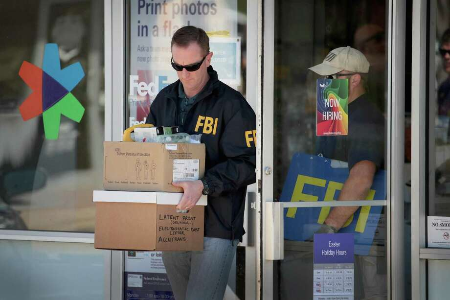 SUNSET VALLEY, TX - MARCH 20:  FBI agents collect evidence at a FedEx Office facility following an explosion at a nearby sorting center on March 20, 2018 in Sunset Valley, Texas. A package, reported to have been shipped from this store, exploded while being transported on a conveyor shortly after midnight this morning at the sorting facility in Schertz, Texas causing minor injuries to one person. The explosion is believed to be related to several recent package bombs that have been detonated in Austin, Texas.  (Photo by Scott Olson/Getty Images) Photo: Scott Olson, Staff / Getty Images / 2018 Getty Images