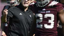 Texas A&M coach Jimbo Fisher talks to players during the first day of spring practice for the Aggies on Tuesday in College Station.