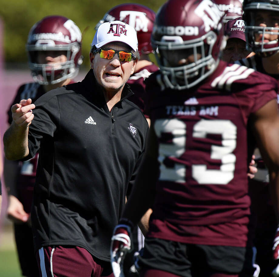 Texas A&M coach Jimbo Fisher talks to players during the first day of spring practice for the NCAA college football team, Tuesday afternoon, March 20, 2018, in College Station, Texas. (Dave McDermand/College Station Eagle via AP) Photo: Dave McDermand, MBR / College Station Eagle
