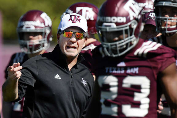 Texas A&M coach Jimbo Fisher talks to players during the first day of spring practice for the NCAA college football team, Tuesday afternoon, March 20, 2018, in College Station, Texas. (Dave McDermand/College Station Eagle via AP)