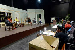 "Beaumont Community Players' rehearse for their upcoming production of Bruce Norris' play ""Clybourne Park"" at the Betty Greenberg Center for Performing Arts Tuesday night. The show explores issues of race and integration offestting tales of a home purchased in 1959 and 50 years later. Photo taken Tuesday, March 20, 2018 Kim Brent/The Enterprise"
