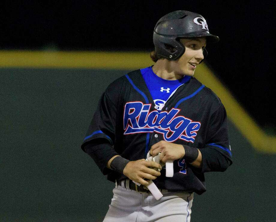 Oak Ridge Chase Roberts smiles after beating the throw to first to reach base during the sixth inning of a District 12-6A high school baseball game at College Park High School, Tuesday, March 20, 2018, in The Woodlands. Photo: Jason Fochtman, Staff Photographer / © 2018 Houston Chronicle