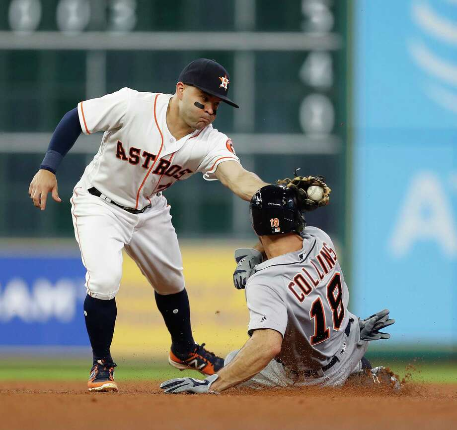 Jose Altuve is unable to catch the Tigers' Tyler Collins on a steal of second last season, a common occurrence for would-be thieves against the Astros' catchers. Photo: Karen Warren, Staff Photographer / Stratford Booster Club