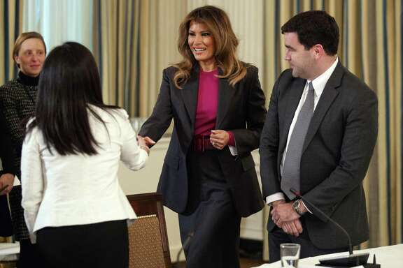 First lady Melania Trump speaks with Snap's Jennifer Park Stout, left, and Twitter's Carlos Monje, right, as she arrives Tuesday for roundtable discussion on cyber bullying.