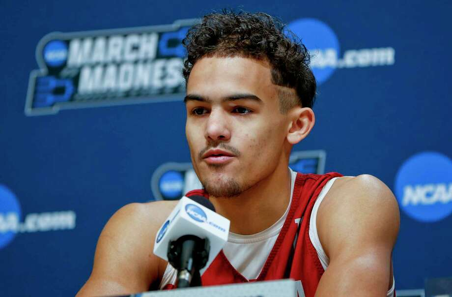 FILE - In this March 13, 2018, file photo, Oklahoma's Trae Young answers questions during a news conference for an NCAA college basketball first round game in Pittsburgh. Oklahoma star freshman Trae Young is leaving for the NBA after a standout season. The 6-foot-2 guard averaged 27.4 points and 8.7 assists this season, and many projections have him going early in the first round. He posted the reasons for his decision on ESPN early Tuesday, March 20, 2018, saying he was ready to put in the work needed to play in the NBA. (AP Photo/Keith Srakocic, File) Photo: Keith Srakocic / Copyright 2018 The Associated Press. All rights reserved.