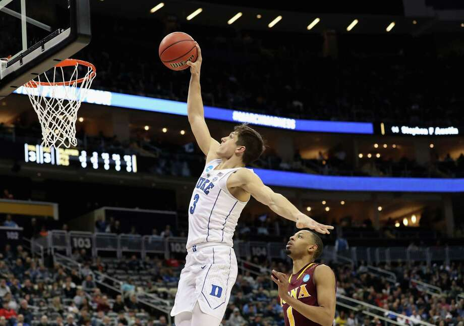 PITTSBURGH, PA - MARCH 15:  Grayson Allen #3 of the Duke Blue Devils takes a shot ahead of Zach Lewis #1 of the Iona Gaels during the second half of the game in the first round of the 2018 NCAA Men's Basketball Tournament at PPG PAINTS Arena on March 15, 2018 in Pittsburgh, Pennsylvania.  (Photo by Rob Carr/Getty Images) Photo: Rob Carr / 2018 Getty Images