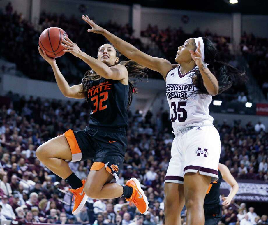 Oklahoma State guard Loryn Goodwin (32) attempts a layup while Mississippi State guard Victoria Vivians (35) defends during the second half of a round-two game in the NCAA women's college basketball tournament in Starkville, Miss., Monday, March 19, 2018. Mississippi State won 71-56. (AP Photo/Rogelio V. Solis) Photo: Rogelio V. Solis / Copyright 2018 The Associated Press. All rights reserved.
