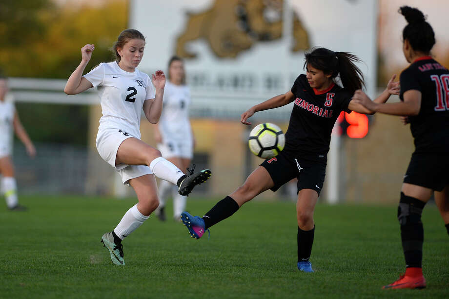 Nederland's Skylar Thomassie challenges Memorial's Juliana Tejeda for the ball at Bulldog Stadium on Tuesday evening.  Photo taken Tuesday 3/20/18 Ryan Pelham/The Enterprise Photo: Ryan Pelham, Ryan Pelham/The Enterprise / ©2017 The Beaumont Enterprise/Ryan Pelham