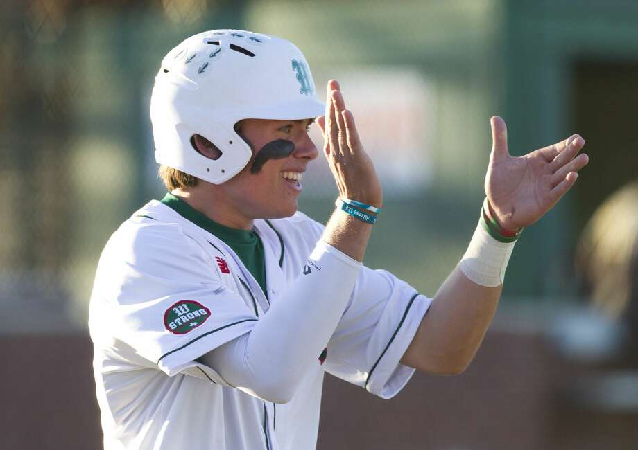 The Woodlands' Casey Sunseri claps after scoring on PJ Villareal's 2-RBI single during the third inning of a District 12-6A high school baseball game at Scotland Yard, Tuesday, March 20, 2018, in The Woodlands. Photo: Jason Fochtman/Houston Chronicle