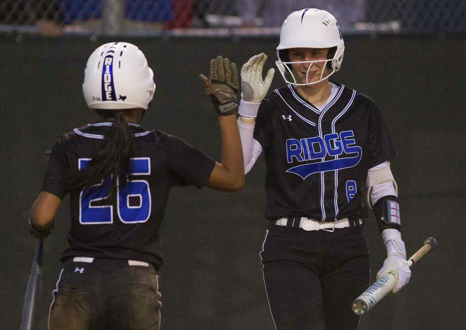 Oak Ridge's Aiyana Freeney gets a high-five Haley Nillen from after second on an error during the fifth inning of a District 12-6A high school softball game at College Park, Tuesday, March 20, 2018, in The Woodlands. Photo: Jason Fochtman, Staff Photographer / © 2018 Houston Chronicle