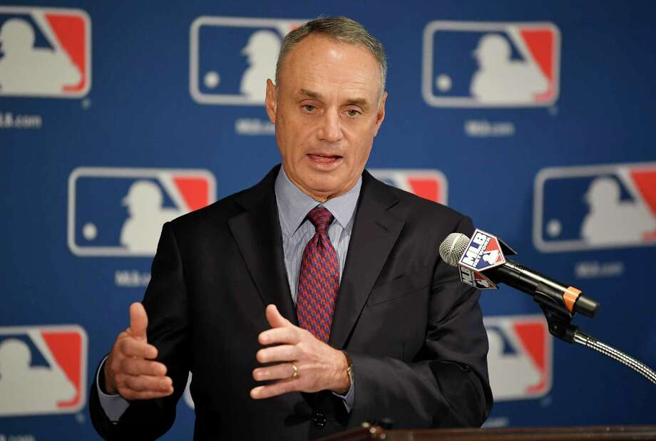 FILE - In this Thursday, Feb. 1, 2018, file photo, Major League Baseball Commissioner Rob Manfred speaks during a news conference at the baseball owners meetings in the Four Seasons Hotel, in Los Angeles. More than a third of U.S. states are considering legalizing sports gambling if the Supreme Court overturns a federal law that has banned sports books in all but Nevada and three other states since 1992. The action at the state level has set off a lobbying battle between casino interests on one side and the NBA and Major League Baseball on the other. (AP Photo/Mark J. Terrill, File) Photo: Mark J. Terrill / Copyright 2018 The Associated Press. All rights reserved.